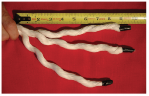 A ruler next to three strands of approximately 10 inches of rope.
