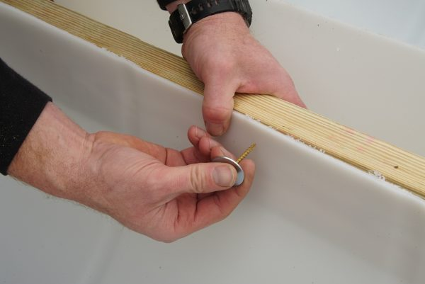 Inserting a screw into wood