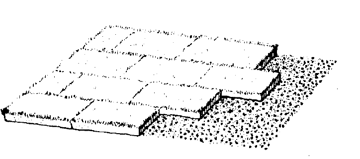 slabs or rolls of sod in a staggered, checker board pattern