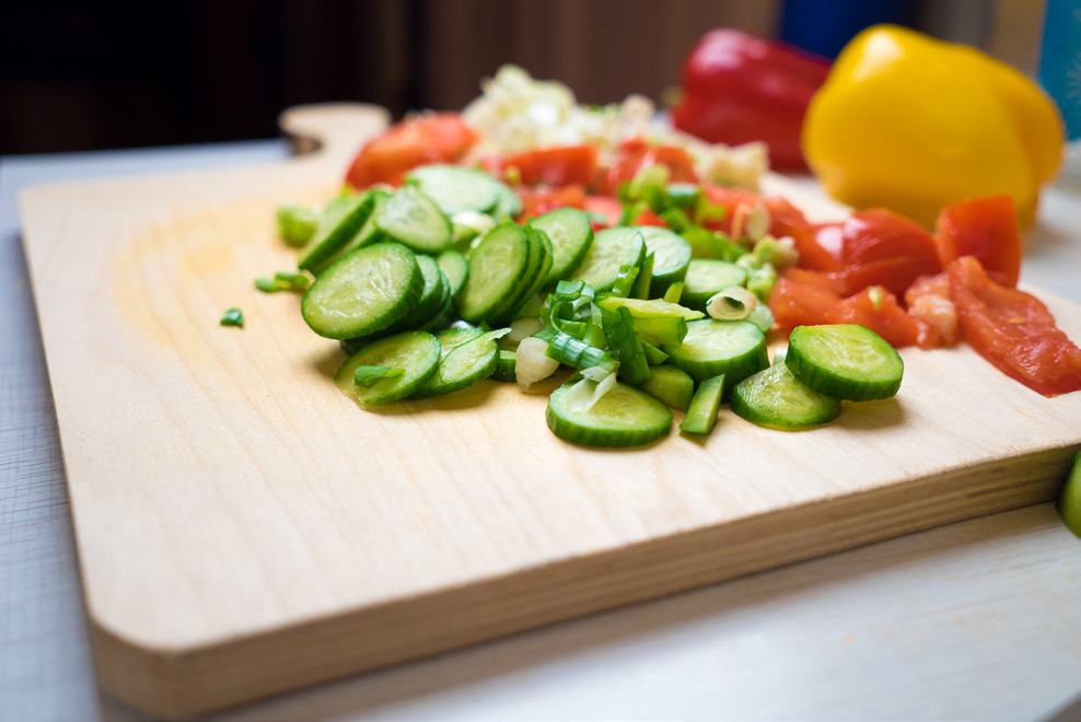 Vegetables cut into pieces on a cutting board.