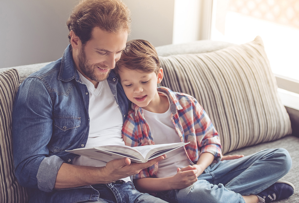 A father reading to his son.