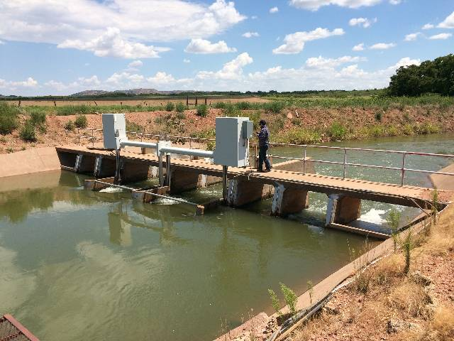 An irrigation canal taking water from Lake Altus in southwest Oklahoma to agricultural fields.
