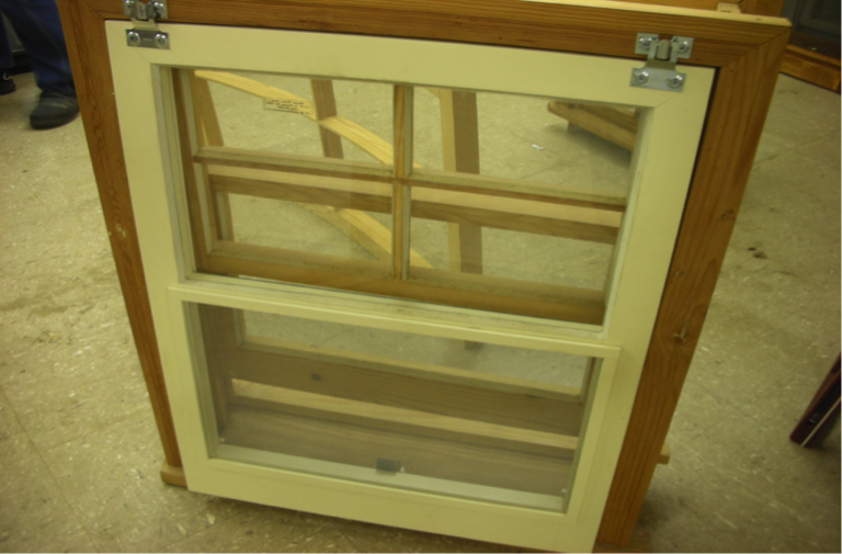 Sliding traditional window with screen made from Southern yellow pine.