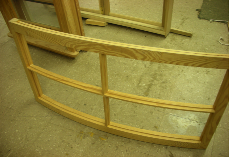 Unfinished curved window made from Southern yellow pine.