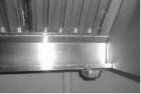 This is a condensation trap on the interior edge of a ventilation hood.