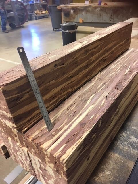A stack of two feet long scrim billets lumber.